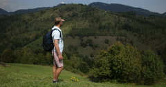 Young Man with Backpack Traveling on Mountain Ridge Tourist Teen Walking Hiking Stock Footage
