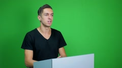 Man making a presentation at green screen background Stock Footage