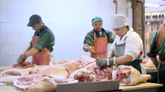 Meat Product Manufacturing. Butchering Room. Employees Working on the Desk, Stock Footage