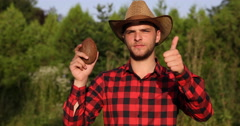 Trustful Caucasian Farm Laborer Showing Coconut and Thumb Up Sign in Green Field Stock Footage