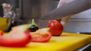 Cook cutting tomatoes on the desk Stock Footage