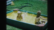 1958: children splashing and playing in a sandbox filled with water AMES, IOWA Stock Footage