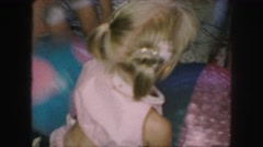 1958: children are seen indoors playing AMES, IOWA Stock Footage