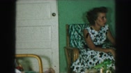 1958: two women lounging in a living room AMES, IOWA Stock Footage