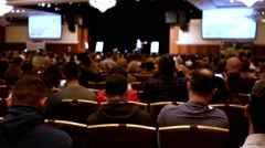 Lecturer tells presentation on the scene to packed house of listeners Stock Footage