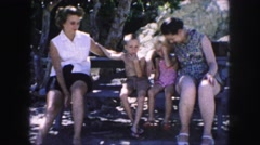 1958: people are seen in a tourist area and are observing a building AMES, IOWA Stock Footage
