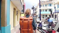 Traveller walking down ecuador streets Stock Footage