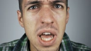 Close-up of an aggressive man screaming Stock Footage