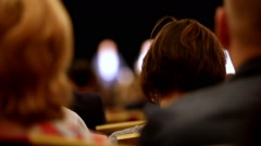 Lecturer tells and shows presentation on the scene to packed house of listeners Stock Footage