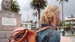Traveller walking through otavalo square Stock Footage