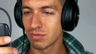 Man moves his head and listens to music on headphones Stock Footage