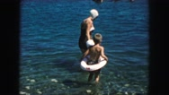 1958: mother and children swimming at birthday AMES, IOWA Stock Footage