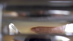 Cook pulling out the dough from a pasta machine. Stock Footage