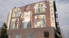 Chips mural panning down to street with cone knocked over in NYC Stock Footage