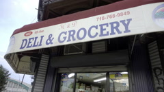 4th Ave Deli and Grocery store sign on corner in Brooklyn NYC Stock Footage