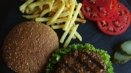 Beef hamburger grill french fries tomato cheese Stock Footage