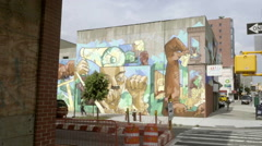 Art mural on Degraw Street panning across avenue in Brooklyn NYC Stock Footage