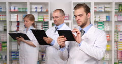 Group of Pharmacists Men Woman Work Activity Drugstore Staff Teamwork Pharmacy Stock Footage