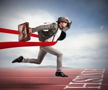 Successful businessman on the finishing line Stock Photos