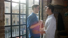 4K Portrait happy young gay couple spending time together in city apartment Stock Footage