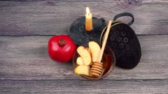 Pomegranate, apple and honey, traditional food of jewish New Year celebration Stock Footage