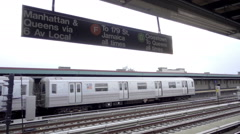 Subway train leaving station platform outdoor elevated track - F and G train NYC Stock Footage