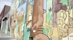Tenant meeting Diaspora art mural in Brooklyn NYC Stock Footage