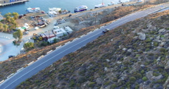 Aerial convertible car driving island coast road sunset mykonos greece 4K Stock Footage