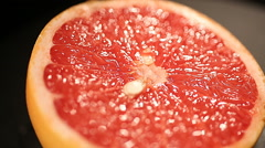 Delicious grapefruit cut for squeezing fresh juice, citrus fruit in healthy menu Stock Footage