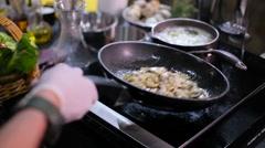 Cook fries mushrooms in a pan Stock Footage
