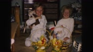 1958: two children enjoy their easter baskets AMES, IOWA Stock Footage