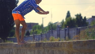 Athlete man doing domestic gainer on the beach Stock Footage
