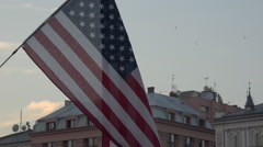 USA flag floating in wind above a crowded square, Krakow WYD 2016 - slow motion Stock Footage