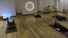 Yoga group of women on floor together in studio Stock Footage