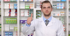 Successful American Pharmacist Man Thumb Up Sign Positive Reply Drugstore Shop Stock Footage