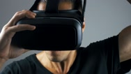 Close-up man put on VR-headset and getting experience in using VR-headset. Stock Footage