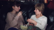 4k Authentic Shot of a Girl with her Mum Talking and Eating Popcorn Stock Footage
