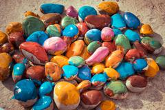 Colored stones lying on a flat surface Kuvituskuvat