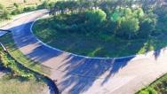 Motorcycle racing 4k aerial video. Moto riders in turn on circuit road track Stock Footage