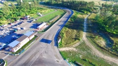 Flying over road racing track 4k aerial video. Races circuit, for motocross Stock Footage