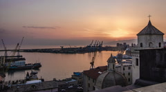 Sunset time lapse of Genoa in Italy Stock Footage