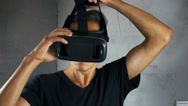 Shot of man getting experience in using VR-headset. Stock Footage