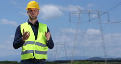 Convinced Engineer Man Talking About Electricity Generation in Industrial Area Stock Footage
