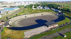 Flying over race track stadium 4k aerial video. Sport circuit race, bleachers Stock Footage