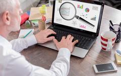 Data analysis concept on a laptop screen Stock Photos