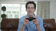 4K Competitive man playing video games at home, as seen from screen's pov Stock Footage
