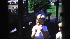 1958: a cute little boy eating a slice of watermelon and spitting out the seeds Stock Footage