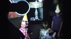 1958: children celebrating birthday party with presents AMES, IOWA Stock Footage
