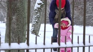 Mother and baby daughter having fun in winter park. 4K Stock Footage