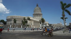 View to central touristic street of Havana. Colorful bright retro cars, trishaw Stock Footage